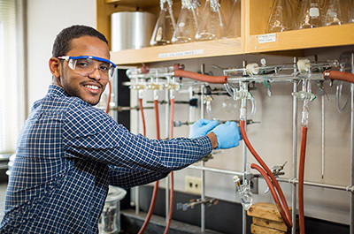 Ahmed Elnaiem at work in the lab as a Posse Scholar at Bucknell.