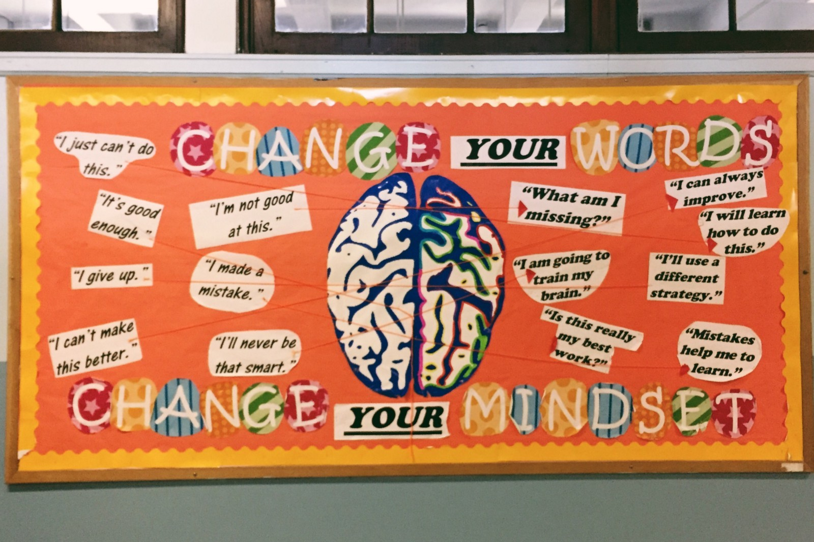 "A ""Change Your Words, Change Your Mindset"" bulletin board at QIRT. (Photo: Madison Darbyshire)"