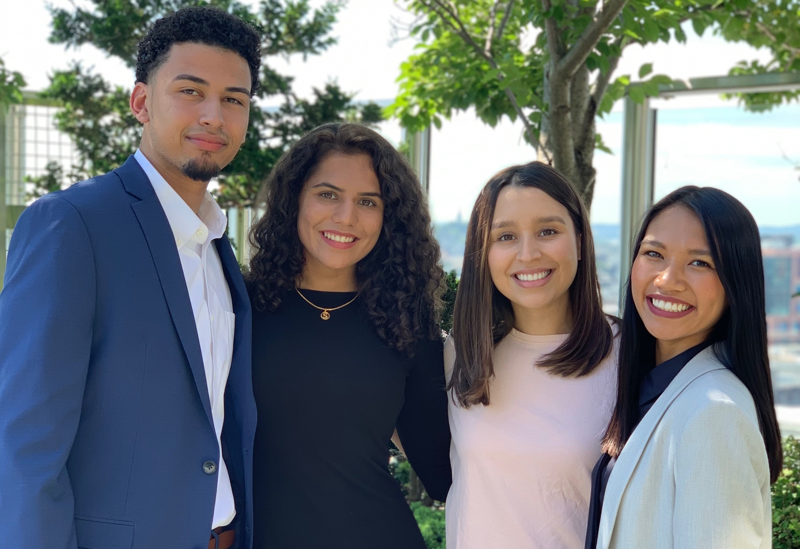 Posse Scholars at Fidelity Investments Asset Management's DISE (Diverse Investors Student Experience) program in 2019, founded by UW-Madison alumna Catalina Hernandez. Left to right: Fernando Barrientos (Denison University), Samantha Harrington, Catalina Hernandez and Camille Raven Molas (Pomona College).