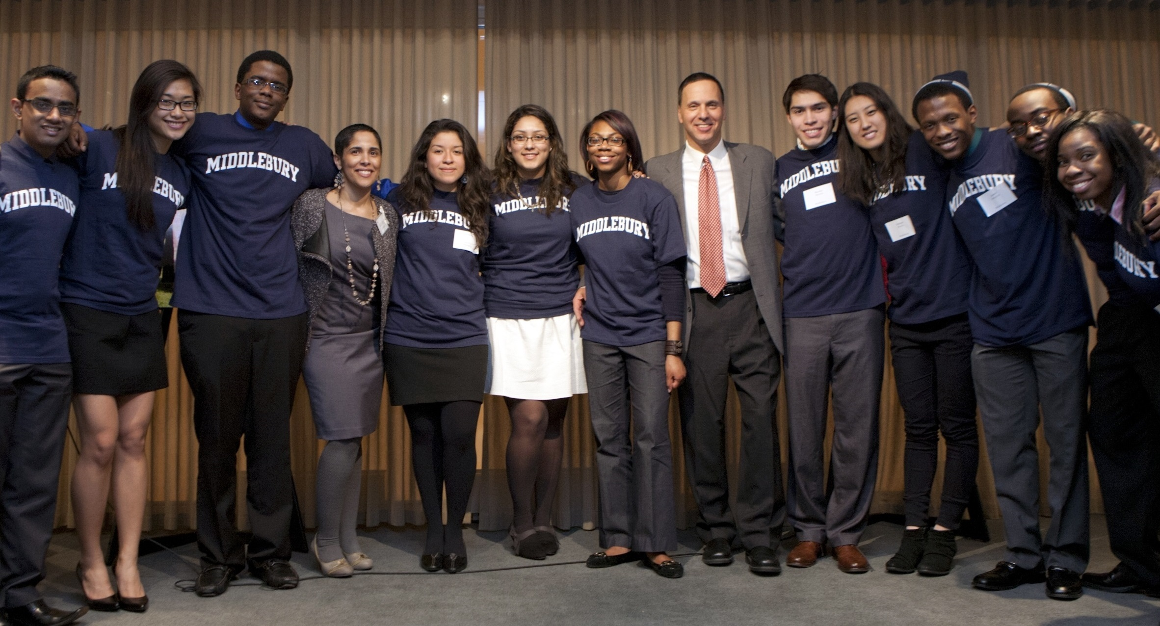 Shirley Collado with a group of Middlebury Posse Scholars and then-President Ron Liebowitz in 2012.