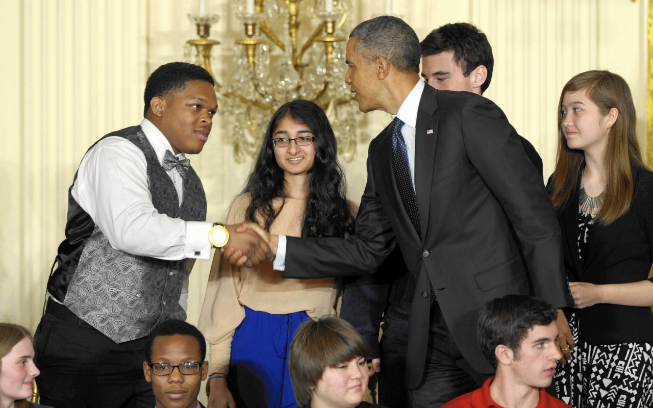 Chicago Tribune: President Barack Obama shakes hands with Posse Scholar Anthony Halmon during a 2013 event celebrating young scientists at the White House. (Susan Walsh / Associated Press)