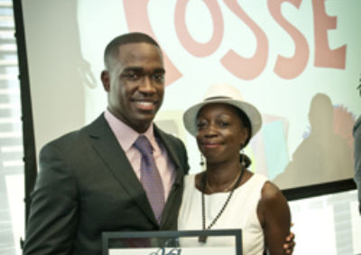 Captain Carmen Green Jr. (Trinity Posse 1, New York) accepts the 2012 Ainslie Alumni Achievement Award with his mother.
