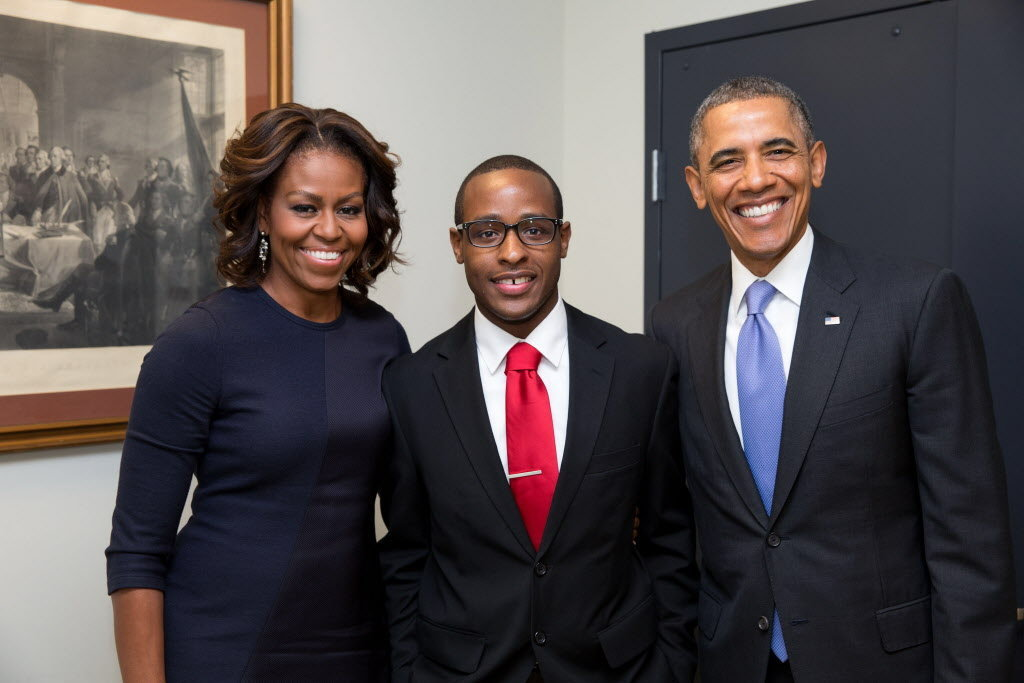 Troy Simon with First Lady Michelle Obama and President Barack Obama in 2014.