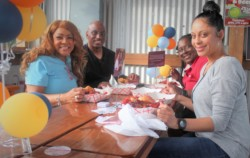 Posse Advisory Board Member Angel Johnson, Curtis Johnson, and guests enjoy crawfish on GiveNOLA Day